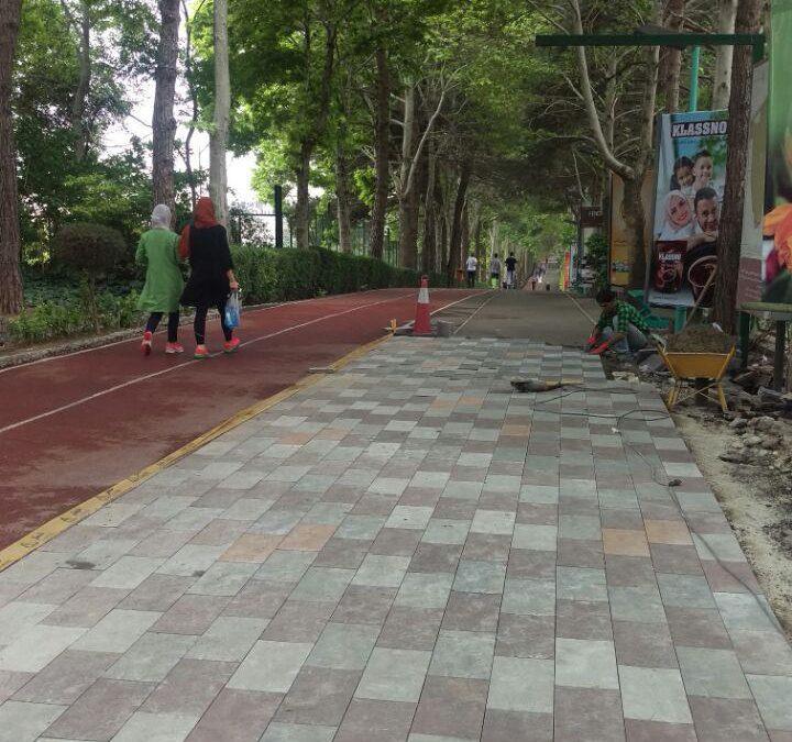 نصب سنگفرش در جاده سلامت باشگاه انقلاب